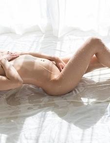 Leggy brunette Juri Kisaragi flashes her pussy with her legs spread on the floor