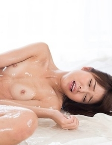 Shino Aoi wearing a cozy bathrobe while giving a great footjob in a chair