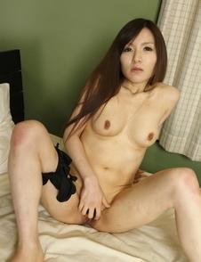 Hitomi Tsukishiro undresses to show hot boobs