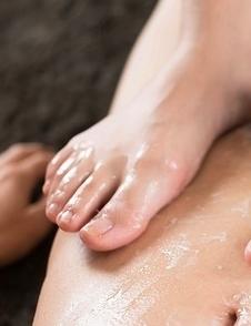Schoolgirl seductress Aino Neko casually jerking a cock with her soft feet