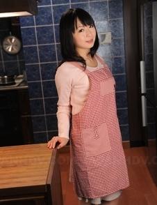 This Asian housewife Nozomi Hazuki poses in