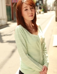 Chika Sasaki in green sweater and short skirt