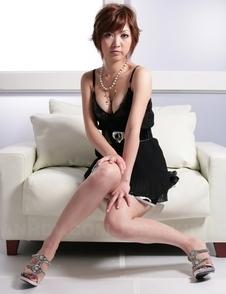 Sayuri Ito with short hair takes black dress