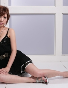Sayuri Ito with short hair takes black dress