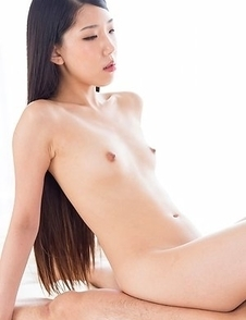 Flat-chested beauty Rio Kamimoto teasing with her bush, pleasing with her toes