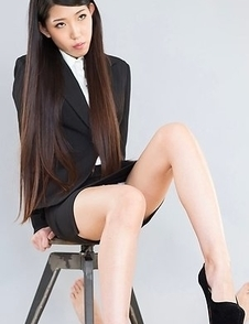 Pantyhose-clad beauty Rio Kamimoto takes them off to give a guy a great footjob