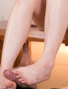 Dress-wearing classy seductress Ryu Enami using her feet to get this dude to cum