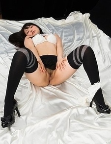 Leggy stunner Sana Iori poses in thigh-highs and finger-blasts herself
