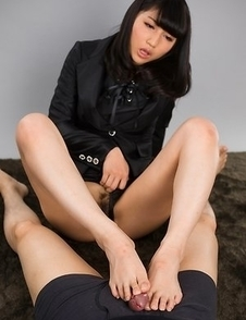 Reo Saionji looks mean and cruel as she jerks his cock with her hot feet