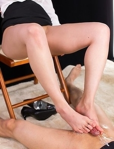 Leggy babe Natsuki Yokoyama jerking this dude's cock with her perfect toes