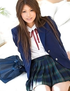 Risa Aika with cute smile shows crack in thong under skirt