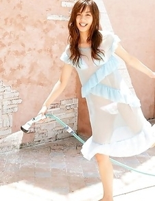Rola Chen plays with outdoor shower on body over lingerie