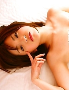 Ryoko Tanaka exposes hot behind in red panty in her bed