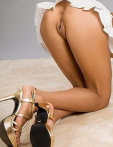 Tanned and leggy mixed Japanese girl Nanami Sugisaki shows her hairy slit on cam