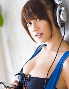 Mikie Hara with big tits and sexy legs listens to the music
