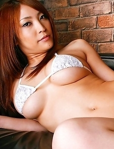 Rika Hoshimi with big jugs shows pussy with thong stuck in