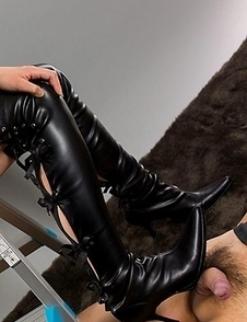 Sena Sakura puts on her tall leather boots to give this dude a footjob