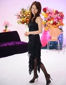 Rino Asuka teases in black dress