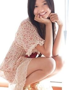 Mayumi Yamanaka smiles while undressing with erotic moves
