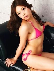 Asuna Kawai in pink bath suit and heels is appetizing model