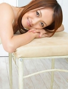 Rina Itoh smiles and shows sexy legs under cute dress