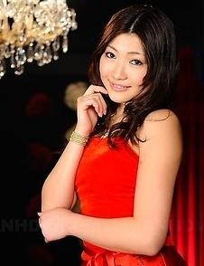 Karin Kusunoki poses in red dress