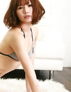 Ai Kumano in bath suit moves with hot gestures on floor