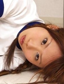 Satsuki Konichi in sports equipment plays at locker room