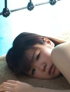 Hikari Azuma plays with bath suit on her generous boobs