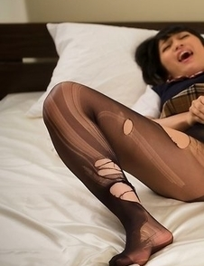 Schoolgirl in pantyhose Reo Saionji using a vibrator to get herself off on camera