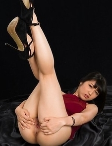 Brunette in red Reo Saionji showing her finger-blasting skills in a hot gallery