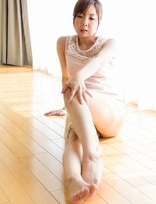 Mio Yoshida lifts up her legs to show off those divine feet on the floor