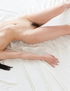 Dark-haired stunner Shino Aoi shows off her succulent pussy on all fours