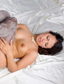 Tanned beauty Misato Kagawa shows off her masturbation skills on a big bed