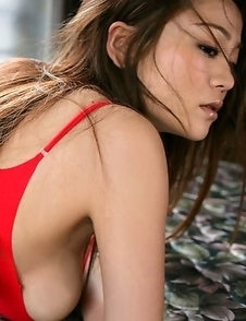 Yoko Matsugane plays with huge cans and shows slit in thong