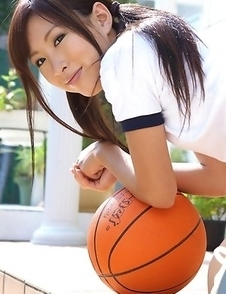 Ayaka Enomoto in sports outfit plays with ball outdoor