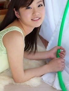 Kana Yuuki in spandex outfit and socks plays with circle