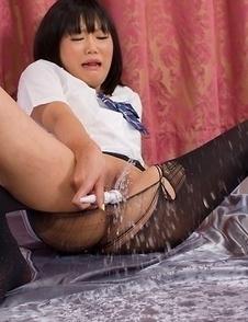 Pantyhose-clad hottie Uta Kohaku using her vibrator to cum buckets on cam